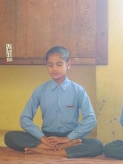 Preeti, a 6th grade student, in meditation.