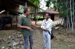 Asit bhai, a member of the Utthan team in Limkheda, speaks with one of the local leaders of the Tribal Development Programme.