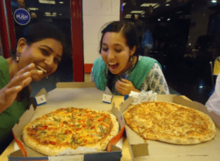 Enjoying the 'local' food with a friend at Bhavnagar's finest dining establishment, Dominos.