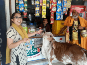 This shopkeeper domesticates local cows, who now enjoy the occasional nuzzle.