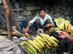 Grilled corn on the cob from the streets of a village in the Himalayas? YES please!