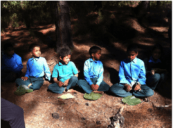 """Students patiently wait to be served the """"Jungle Kitchari"""" they helped prepare."""