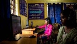 Young women display computer proficiency in a MAST center outside of Kolkata