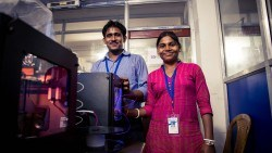 Two beneficiary's of AIF's MAST partnership with Anudip in Kolkata posing near a 3D printer