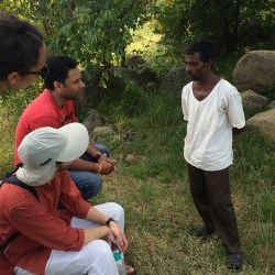 The group speaking with one of the farmers involved in the area's watershed management projects.