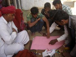 Picture 4: - Villagers explaining the impact of the watershed construction
