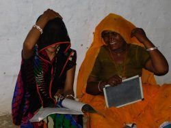 Picture 4: - The women with their books and slates all ready to begin a new day at school