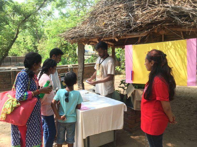 Karthik (volunteer) and Anjana (zoo educator) teach Croc Bank visitors about proper waste segregation on Earth Day.
