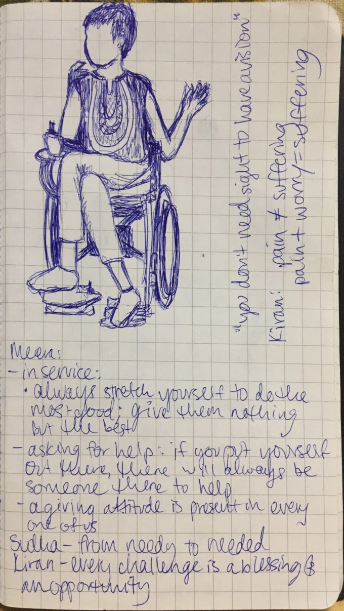 A page of notes from various speakers, and a sketch of a participant in a wheelchair.