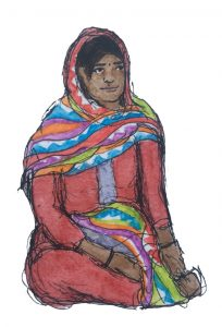 A woman seated cross-legged on the floor, wearing a red sweater and pants and a multicolored patterned scarf.