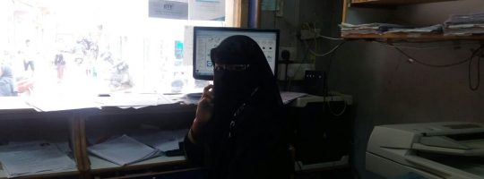 Suhana, a burka clad 17 year old, filling in applications on the computer.