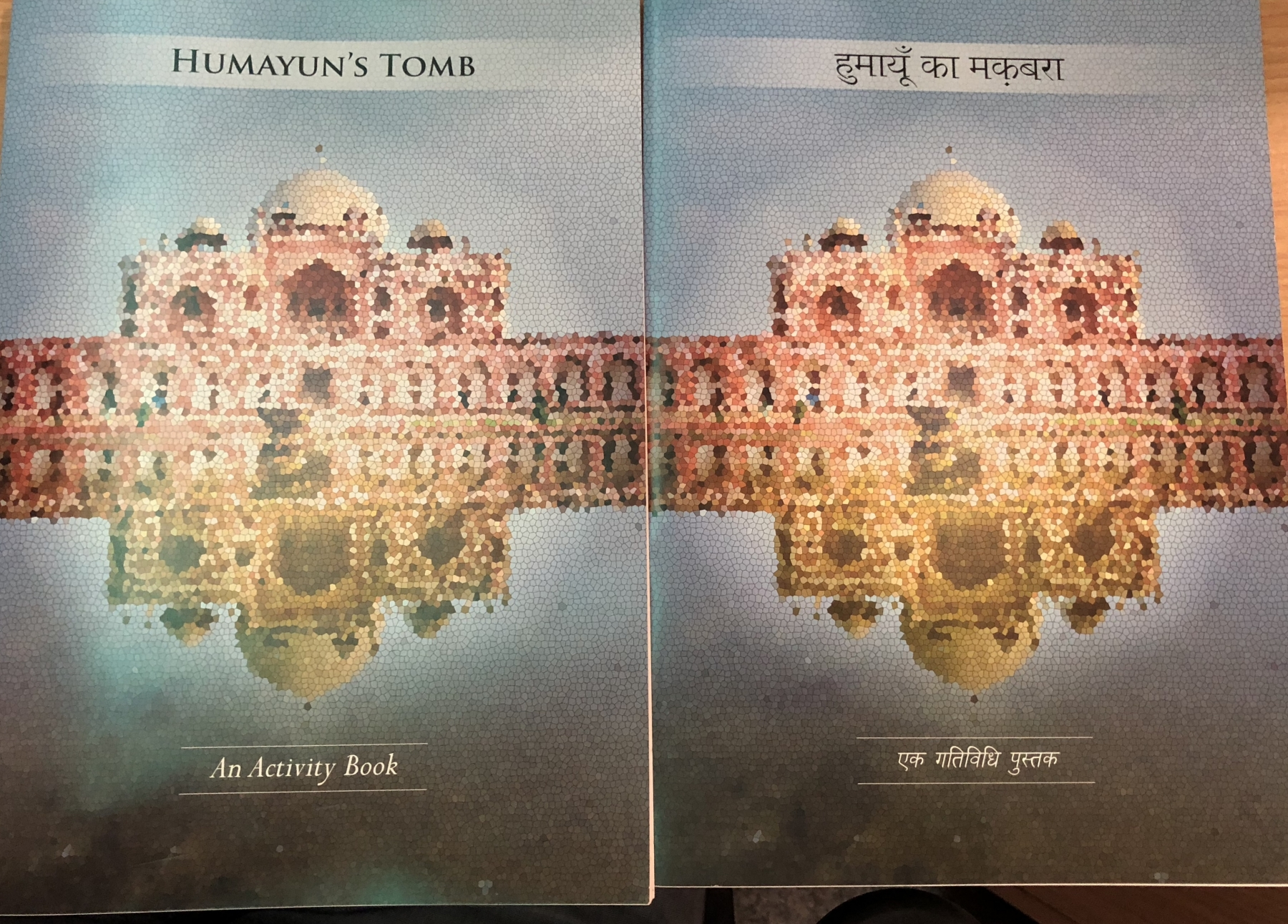 Photo of a bilingual English-Hindi activity book about Humayun's Tomb, depicting a mosaic of Humayun's Tomb on the cover.