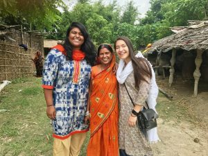Photo of Nithya posing with an Indian woman with another student from the U.S.
