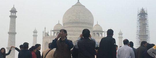 The Taj Mahal obscured by people taking pictures
