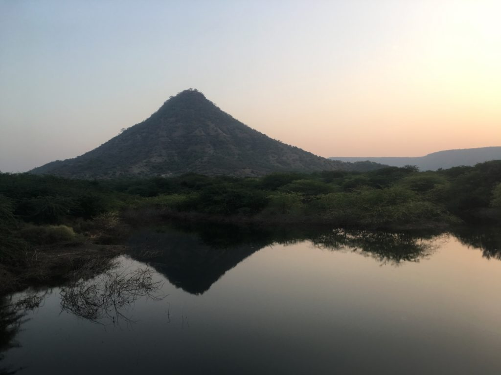A mountain reflected in still water