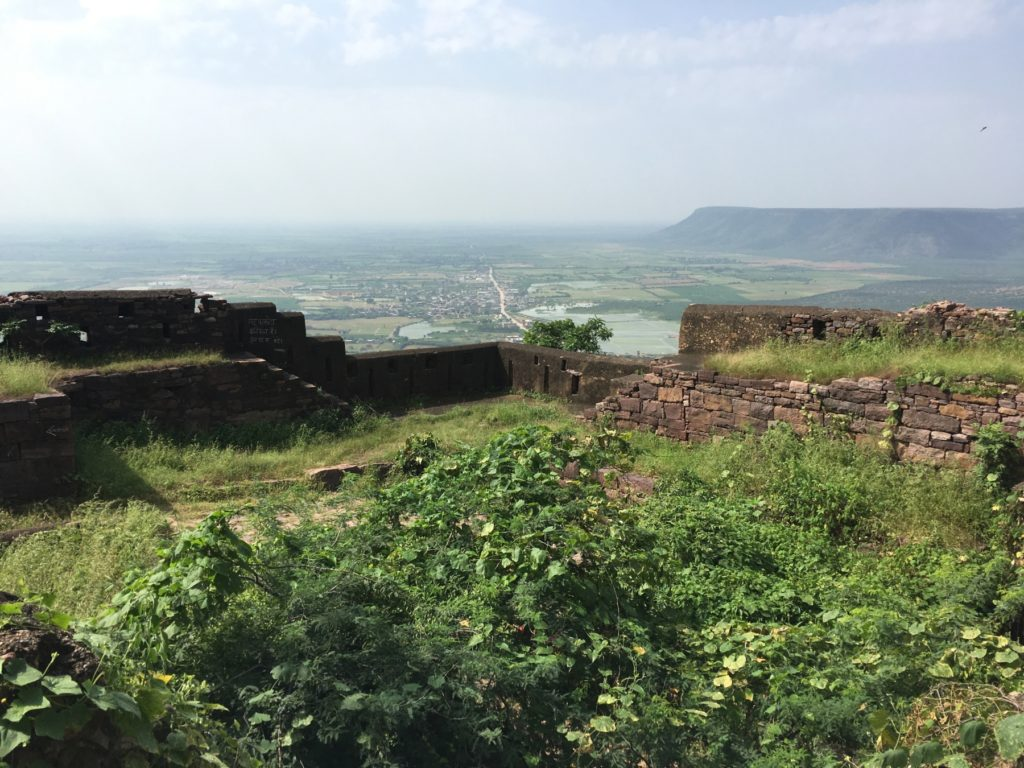 Looking over a decaying fort at the town below