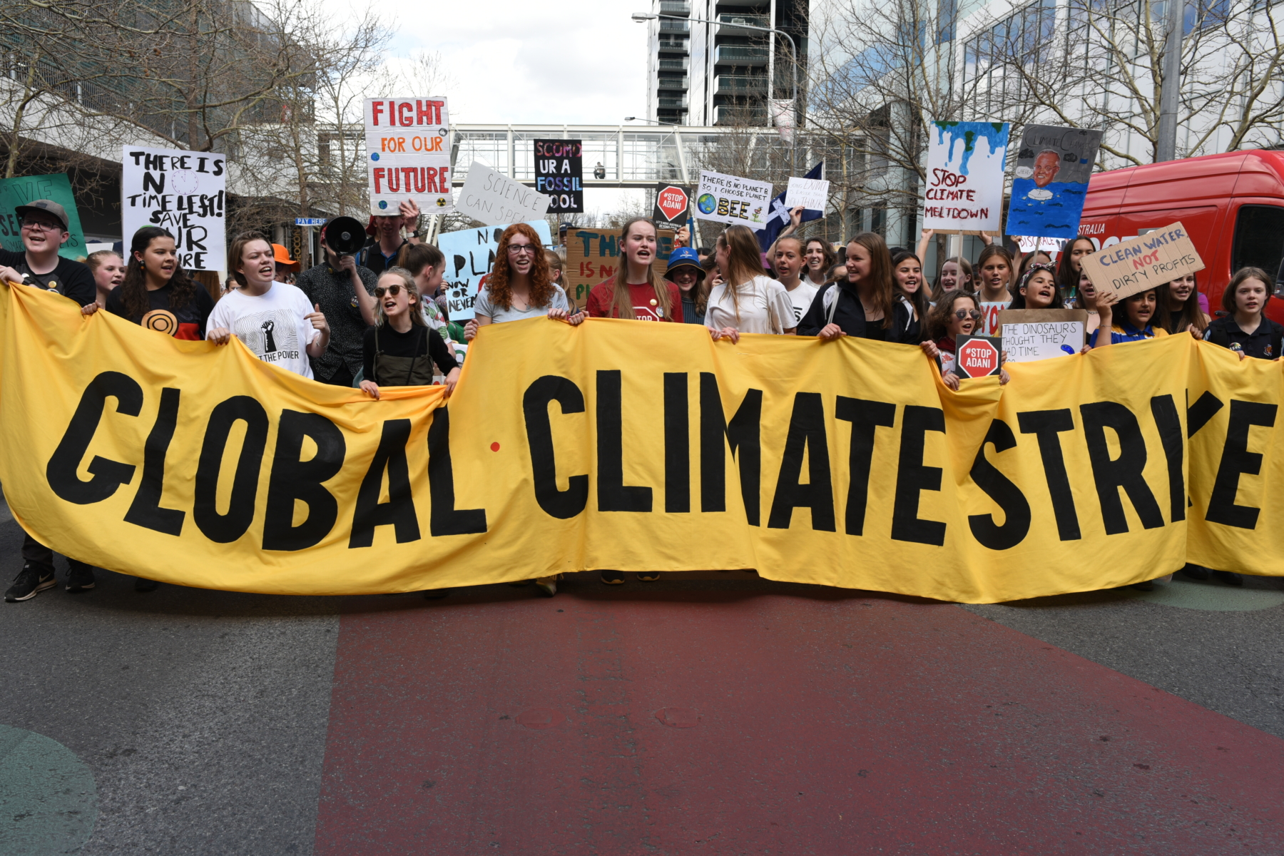 Protesters hold a sign reading Global Climate Strike.