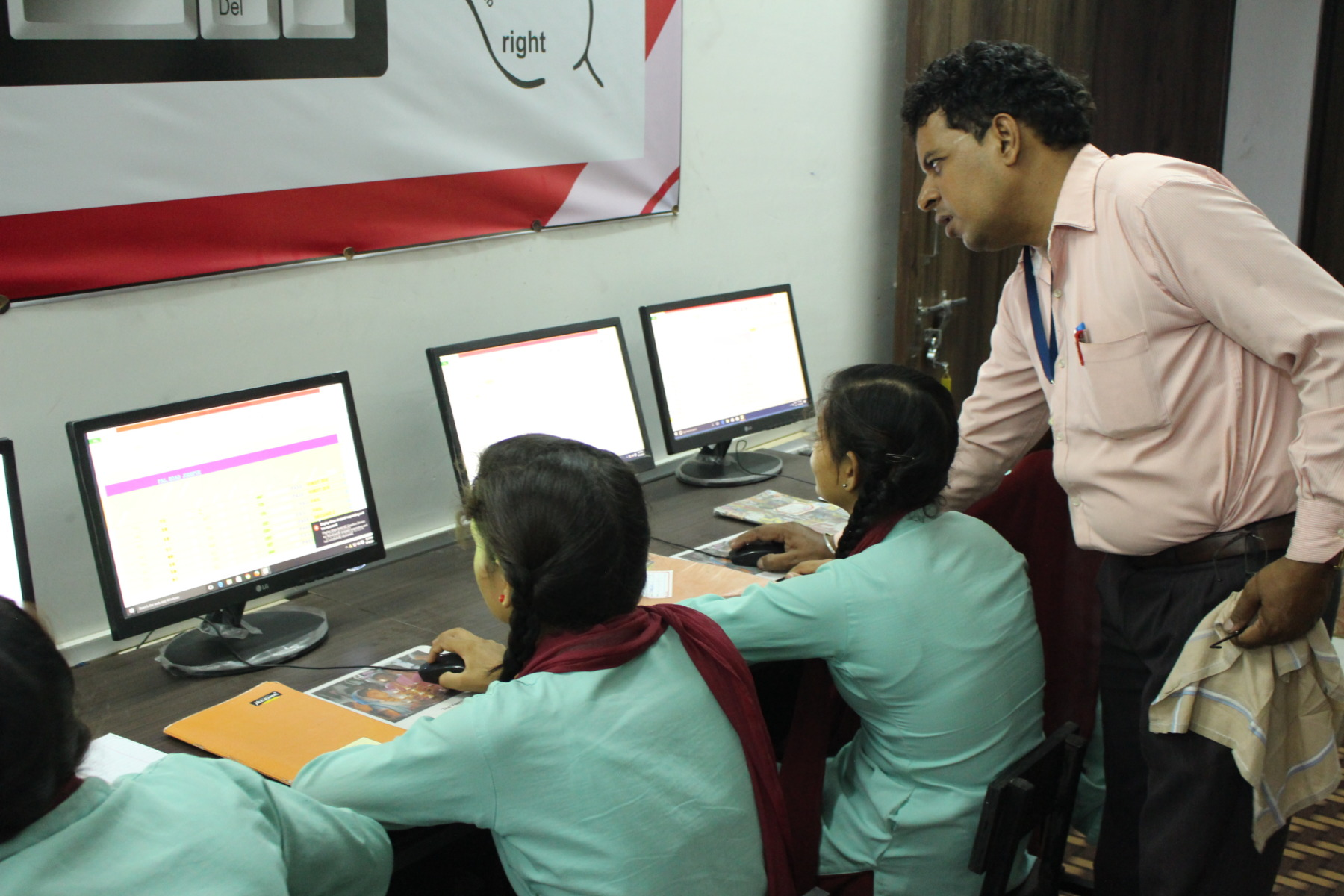 (Image of a computer class being conducted at Veerni's campus by an outsourced computer teacher.)