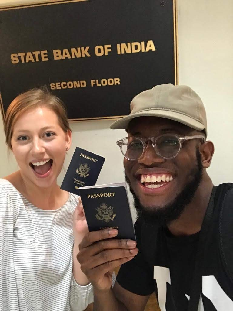 Ismael and the author holding up their new visas