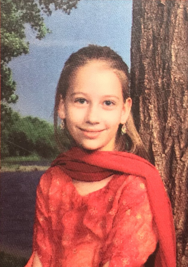 Authors 3rd grade yearbook photo, in which she is wearing Indian clothes.