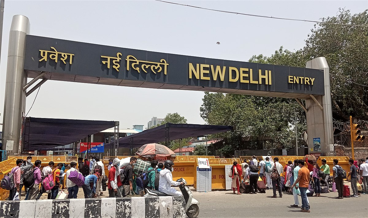 Stranded people rushing to New Delhi railway station to catch their train during fourth phase of the lockdown
