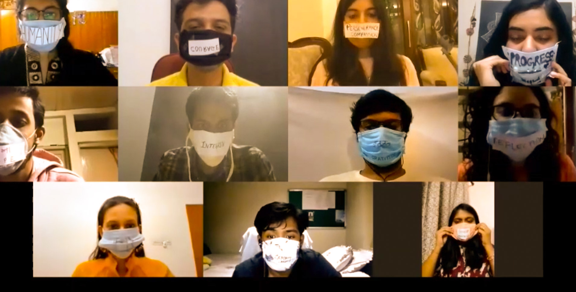 Eleven Fellows wearing masks with words written on them.