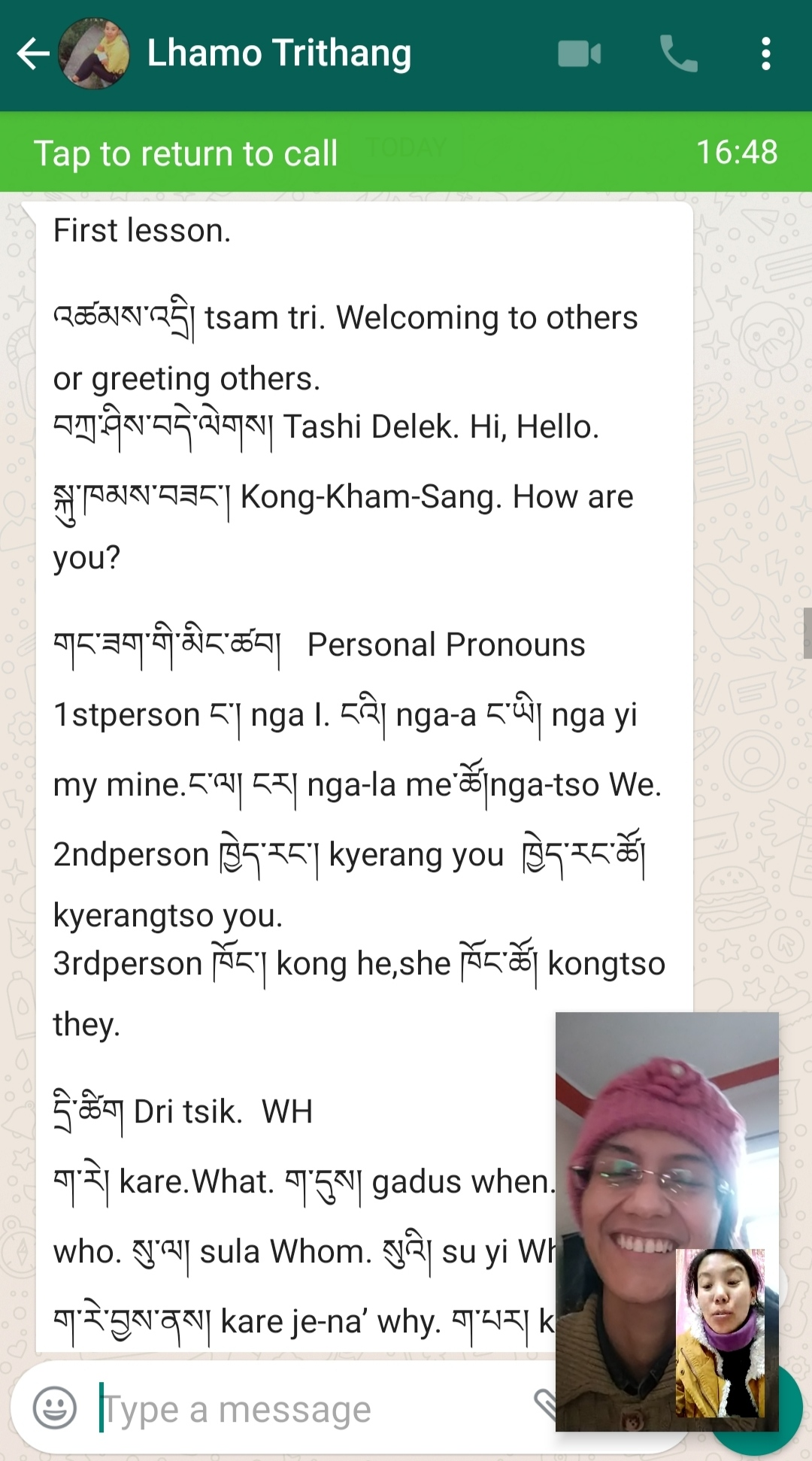 Screenshot of Ms. LLhamo Trithang and Shivangi on a Whatsapp video call, with a text of the first lesson outline in the background: welcoming others & personal pronouns.