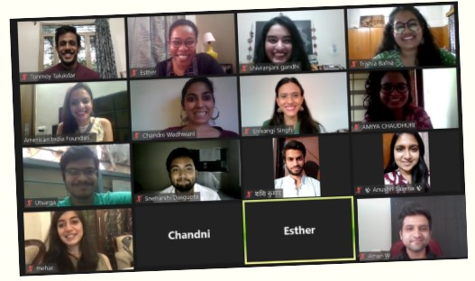 Eleven Fellows with staff members smiling during a Zoom session.