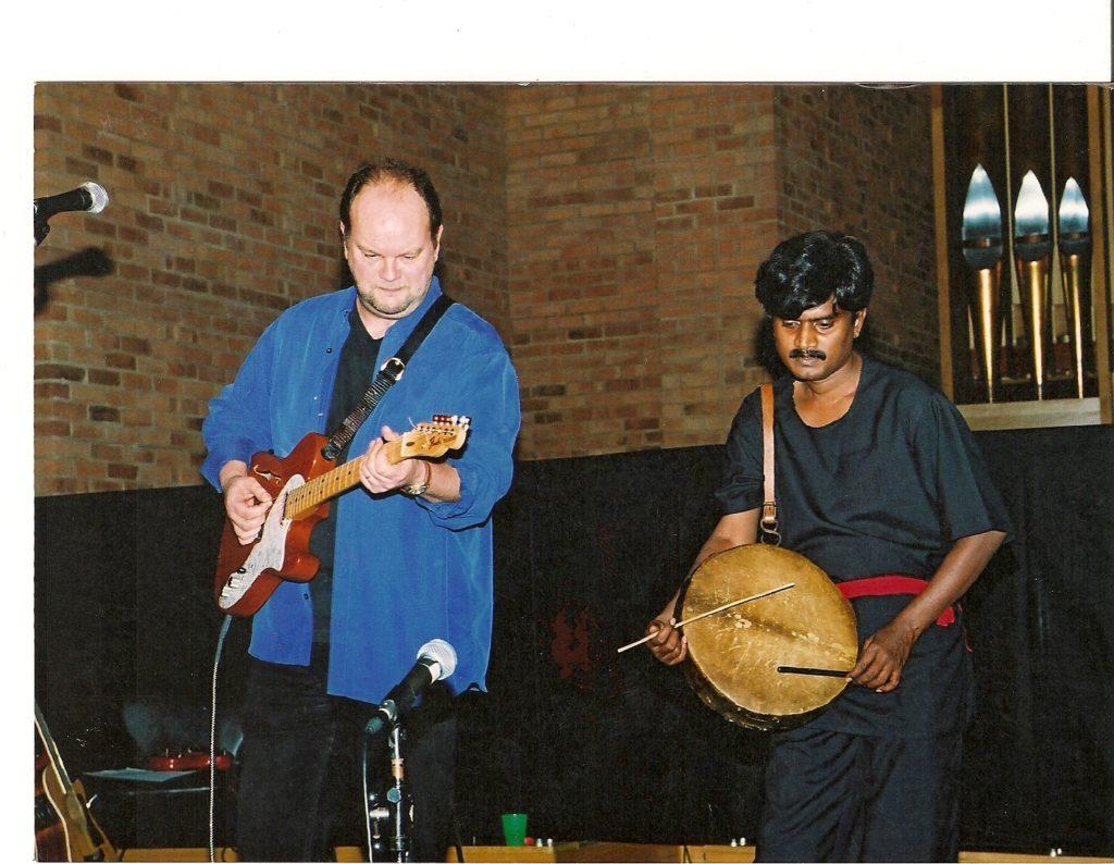 A duet performance of a dappu player and a guitarist.