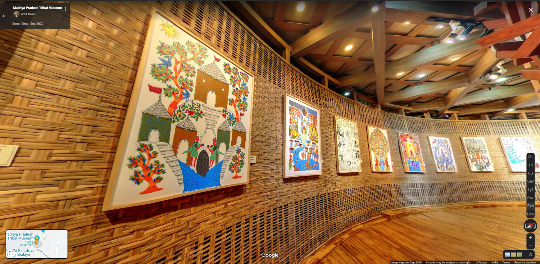 Museum wall showing 8 paintings in bright colors and in various geometrical shapes.