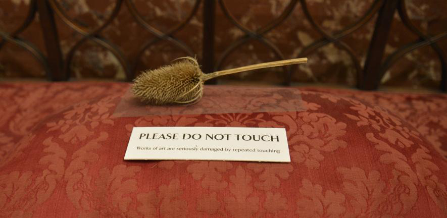 Sign reads: Please do not touch. Works of art are seriously damaged by repeated touching.