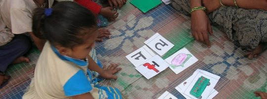 Children learning the Hindi alphabet at a school in India.