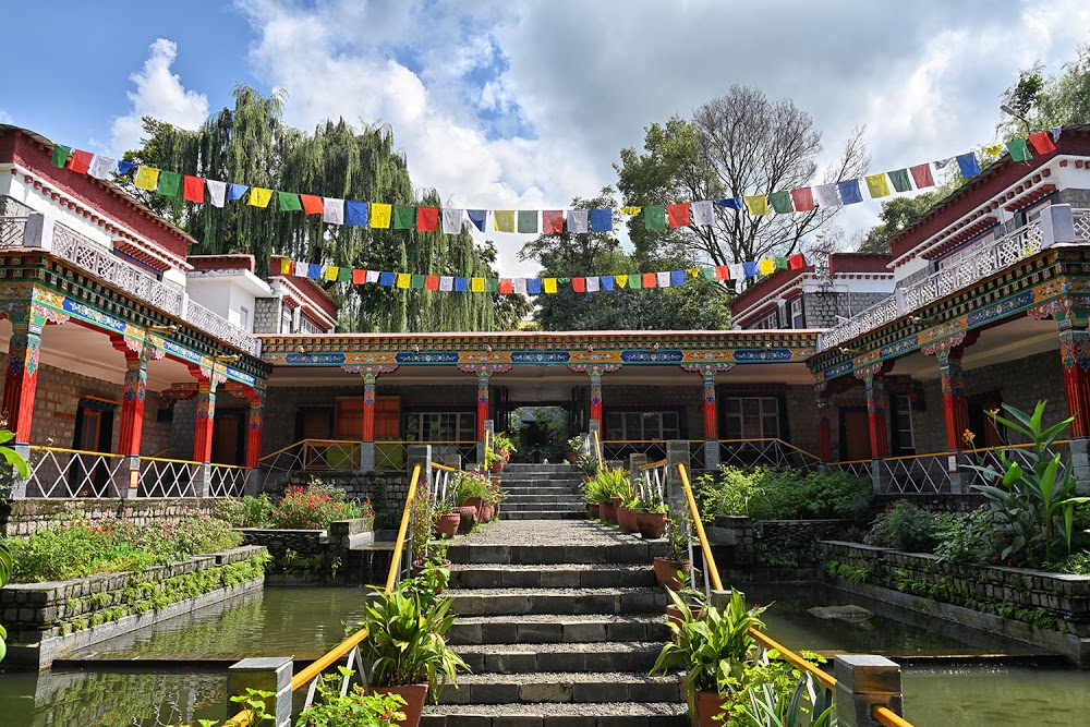 Scenic view of Norbulingka Institute with Steps, building, Tibetan Flags, ponds