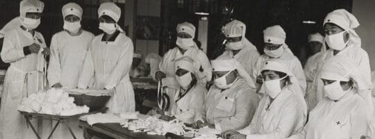 """""""Red Cross workers make anti-influenza masks for soldiers in Boston, Massachusetts in 1918"""". Source: National Archives News, USA"""