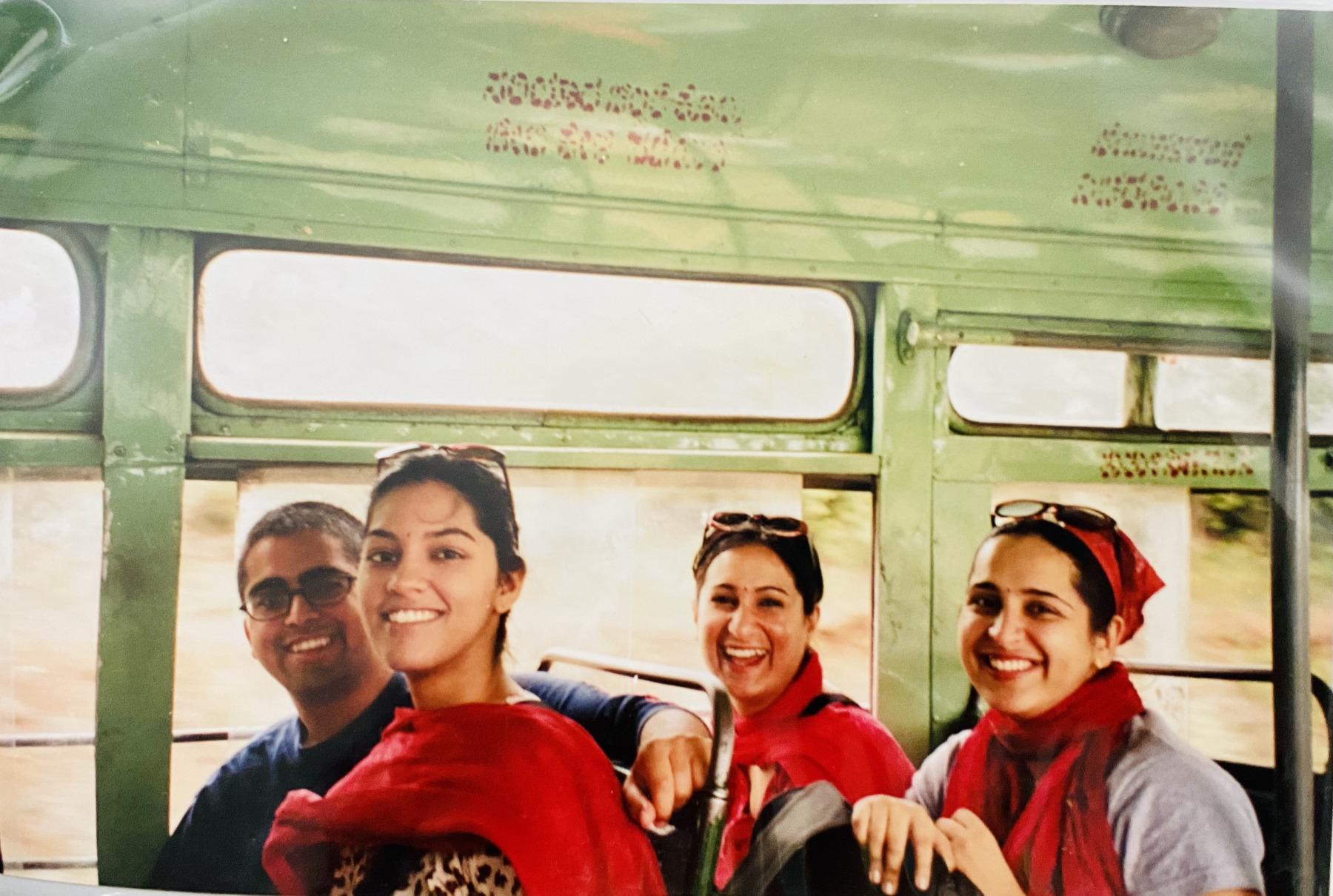 Tanvi, Vikas, Meenakshi and Manju riding on a local bus.