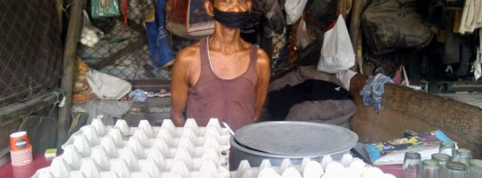 A man with his food stall