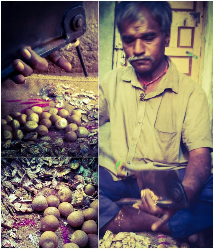 Profession of a betel nut cracker slicing the seeds into finer morsels that would later be used in the preparation of pan.
